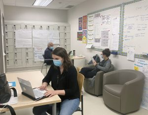 Schedulers at the Redeployment Centre work diligently behind the scenes to coordinate upcoming active screening shifts.